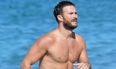 Scott Eastwood Goes Shirtless & Looks Incredibly Buff While Taking A Dip In The Ocean In Hawaii