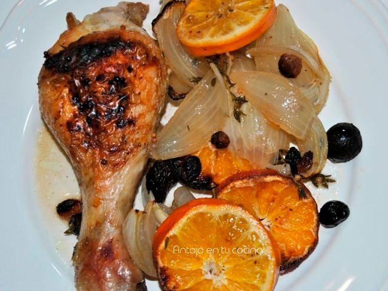pollo asado con mandarina y pasas