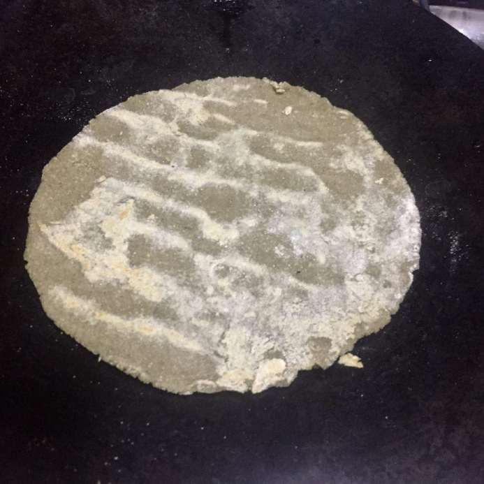 Cook roti.