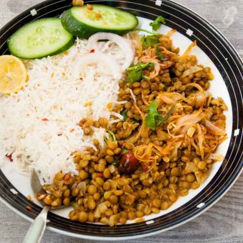Masoor and rice served in a plate.