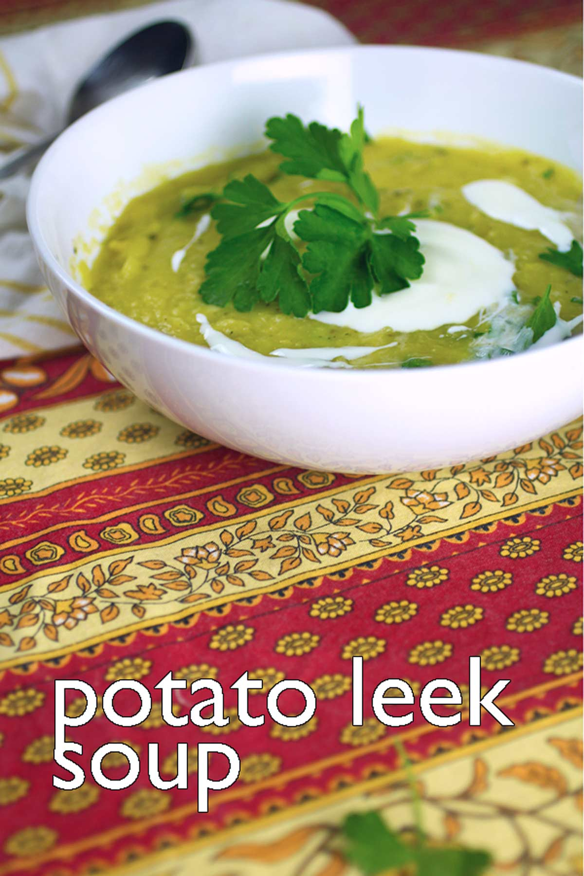 comforting simple potato leek soup garnished with tangy yogurt and parsley