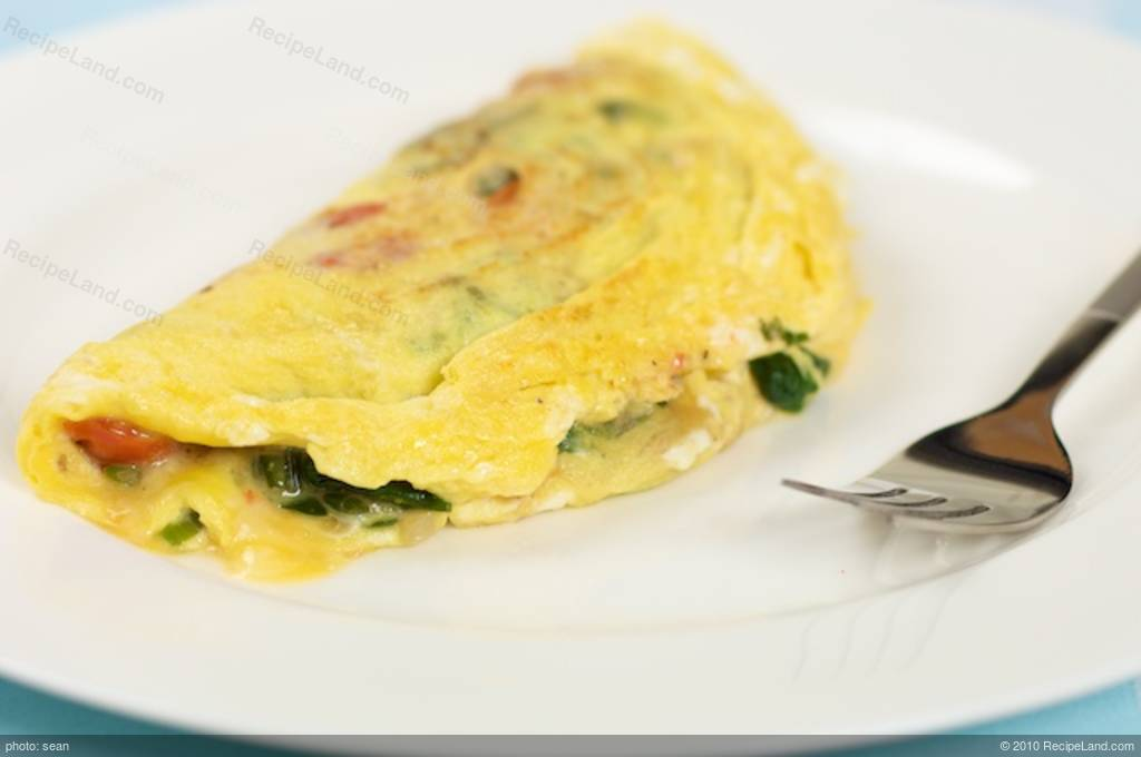 Breakfast Spinach And Tomato Cheese Omelet Recipe