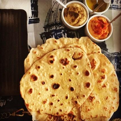 Homemade Naan to accompany: Paprika-based Hummus, Chat Masala-based Hummus, and seasoned Olive Oil