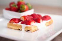 Waffles with Strawberries and Vanilla-Honey Yogurt Sauce