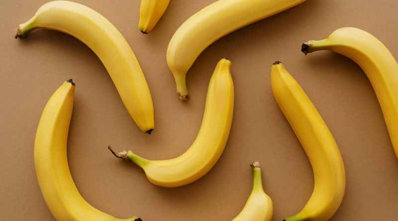 yellow banana fruits on brown surface