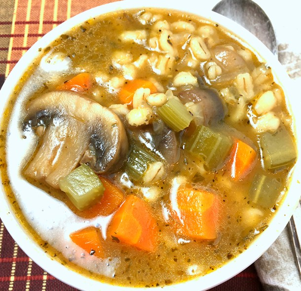 a bowl of mushroom barley soup made in an Instant Pot