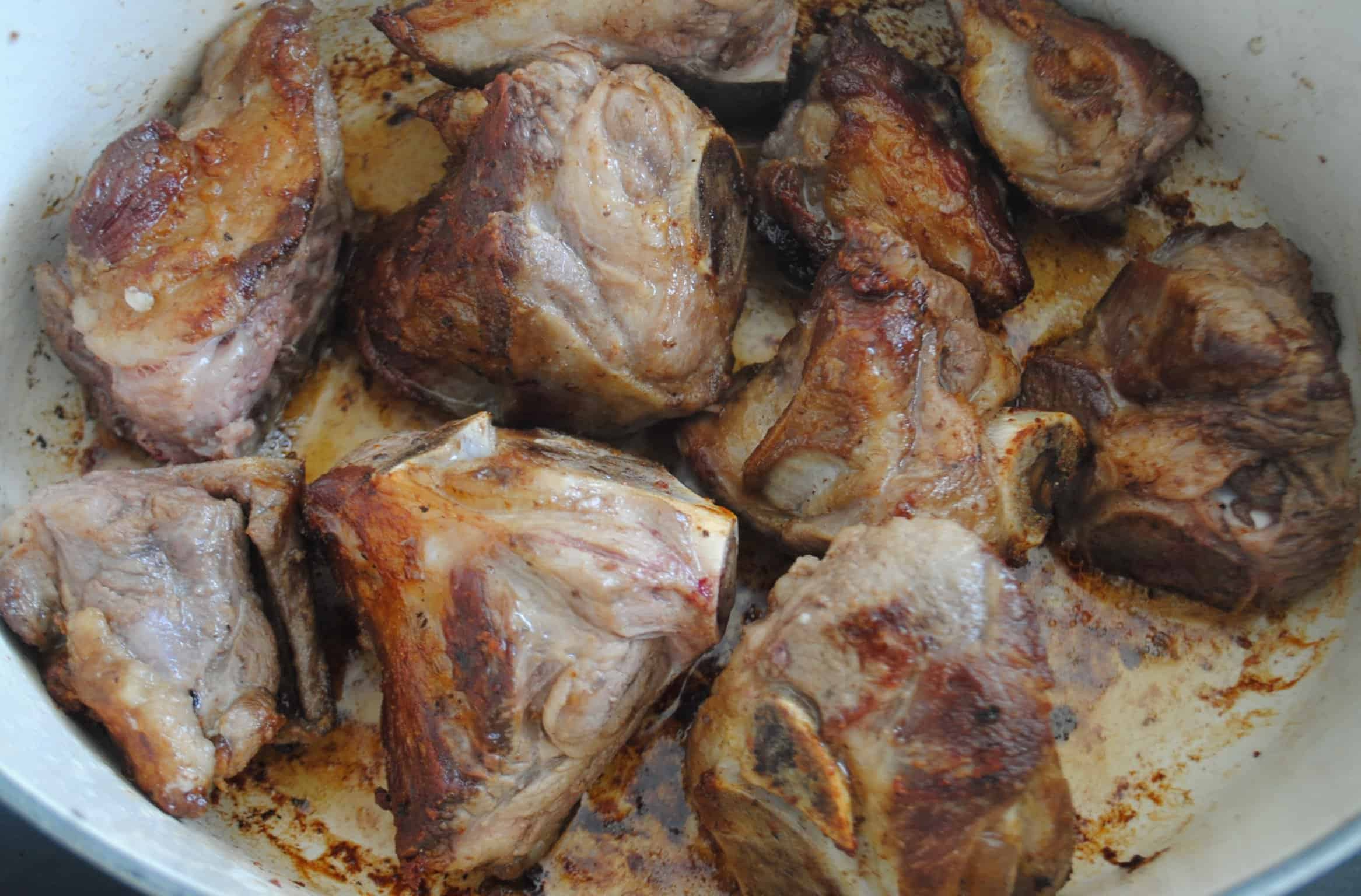 Lamb for Harira soup browning in large pot