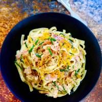 smoked salmon and lemon pasta in black bowl