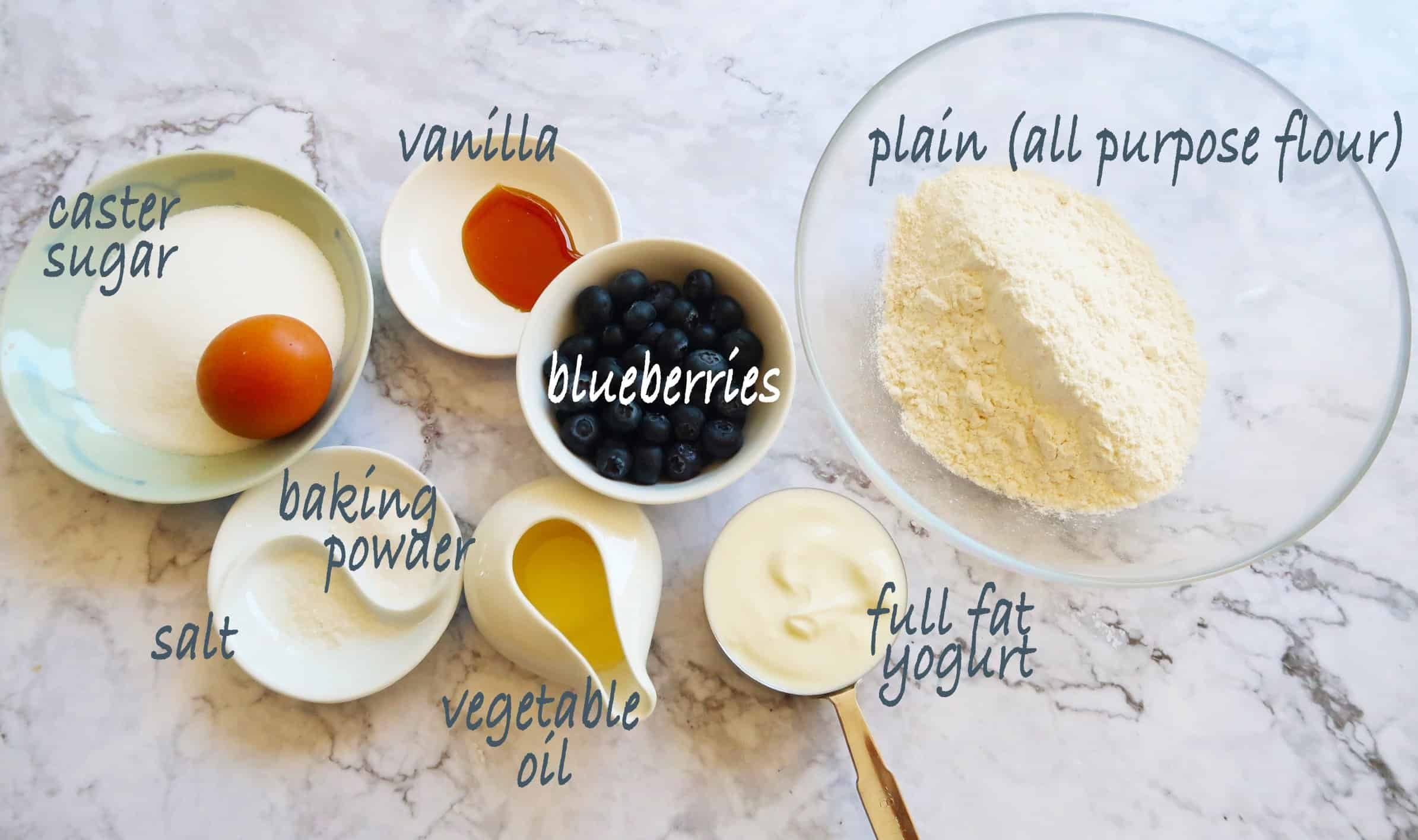 Blueberry streusel muffins ingredients in bowls with name tags