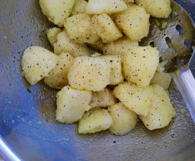 crispy roast potatoes boiled, drained then tossed to rough up the edges