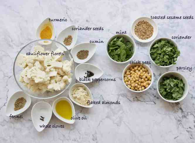 ingredients for Roasted Cauliflower Salad with Garlic Yoghurt Dressing on a marble table