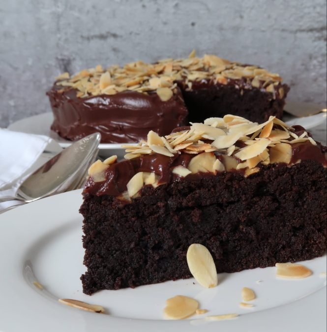 chocolate almond cake served on a white plate