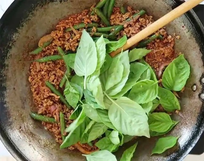 basil added while cooking Chilli Jam Pork Mince with Beans and Basil