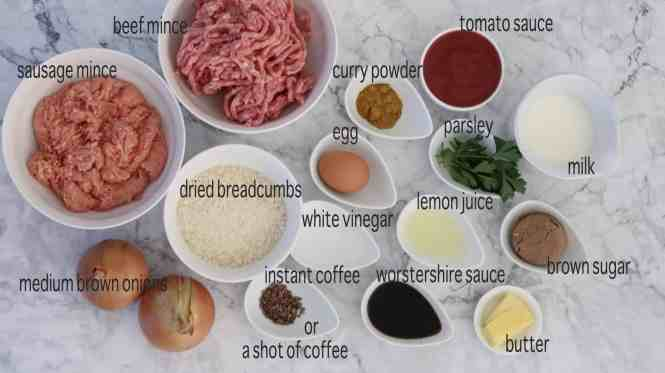 ingredients to make Meatloaf with BBQ Glaze on a marble table