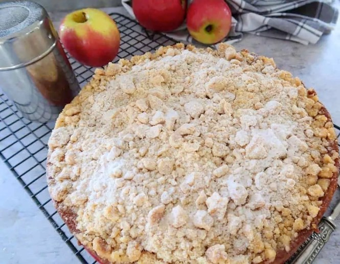 fresh apple crumble cake cooked and dusted with icing sugar