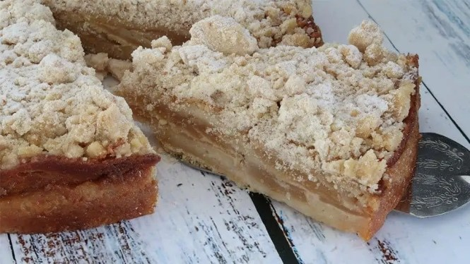 Fresh Apple Crumble Cake with a slice cut from the cake