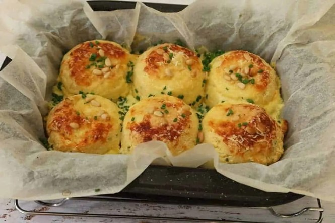 a baking tray with freshly cooked Easy Twice Baked Cheese Souffles