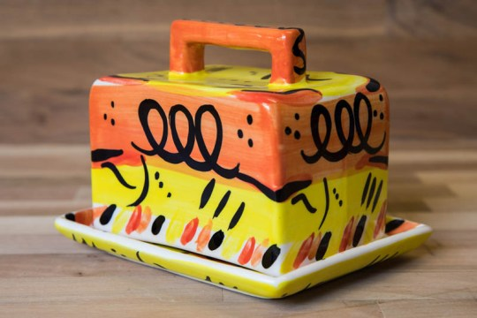 Abstract butter dish in yellow