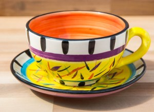 Splash cup and saucer in Yellow