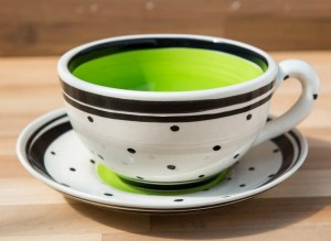 Black and white cup and saucer in polka dot