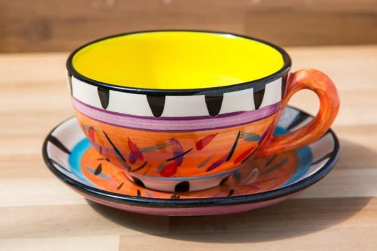 Splash cup and saucer in Orange