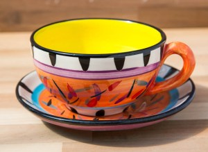 Splash cup and saucer in Orange