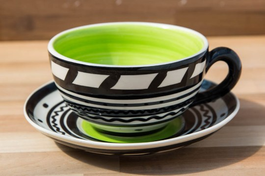 Black and white cup and saucer in banded