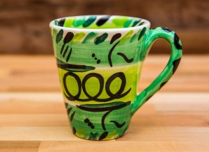 Abstract large tapered mug in green