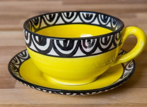 Aztec cup and saucer in yellow
