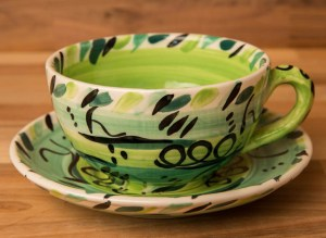 Abstract cup and saucer in green