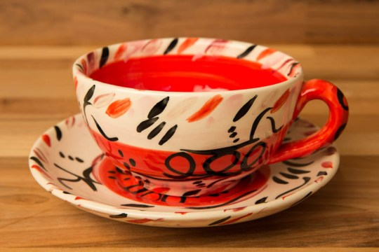 Abstract cup and saucer in red
