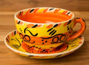 Abstract cup and saucer in yellow