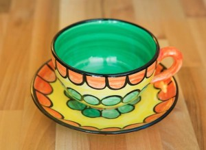 Fruity cup and saucer in orange