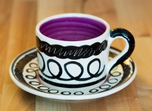 Black and white small cup and saucer in scribble