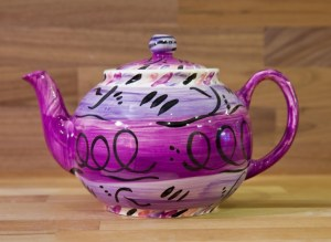 Abstract small teapot in purple