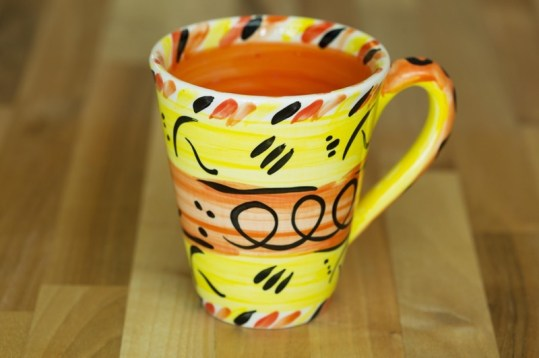 Abstract small tapered mug in yellow