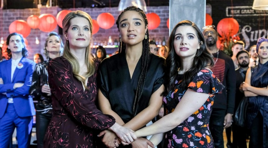 Sutton, Kat and Jane holding hands.