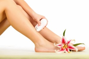 Woman using the epilator on her beautiful legs.
