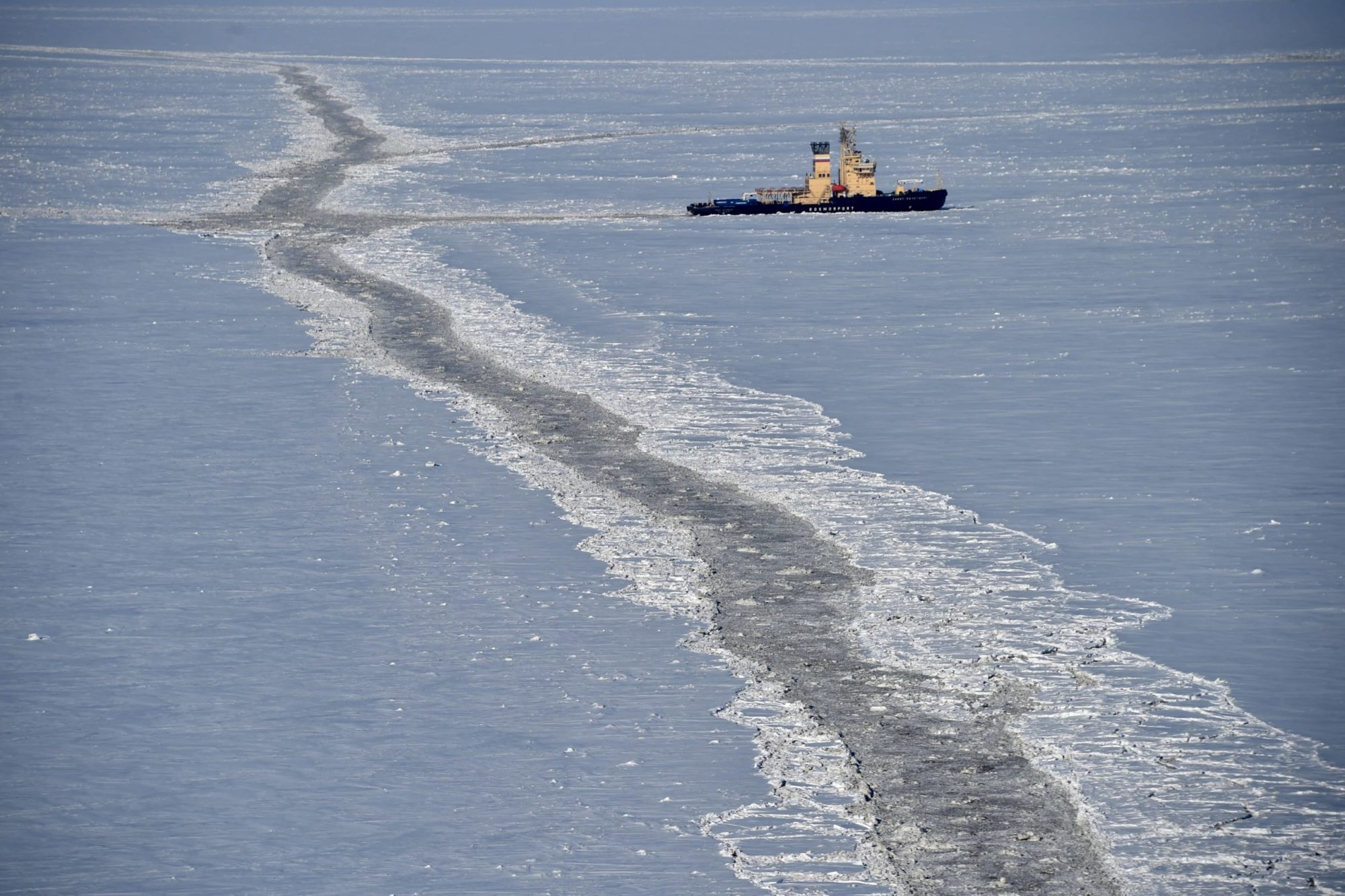 A commercial ship traverses through the Arctic ice cap.