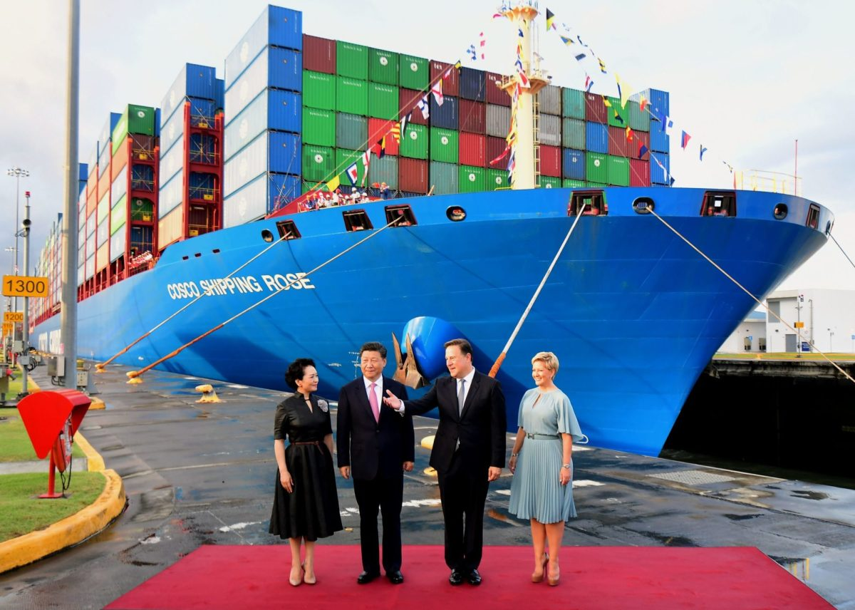 Senior Chinese and Panamanian officials are welcomed at a shipping port.