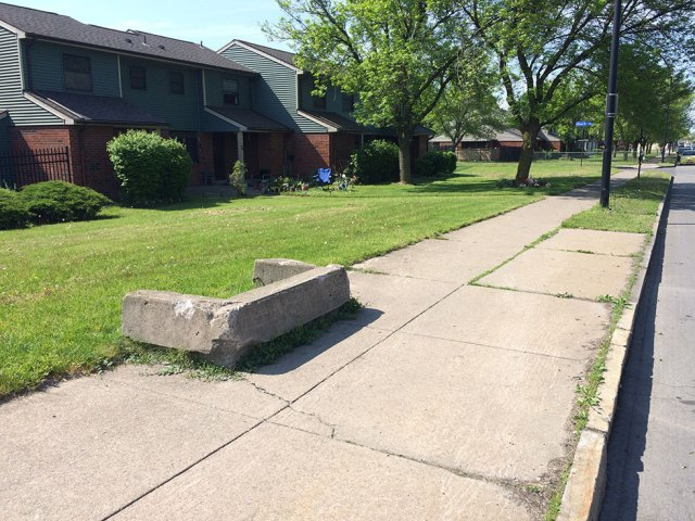 What is this concrete thingy jutting out into the sidewalk on Joseph Ave?