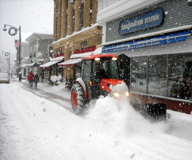 A sidewalk sweeper makes it's way down Main Street in Lake Placid, NY.