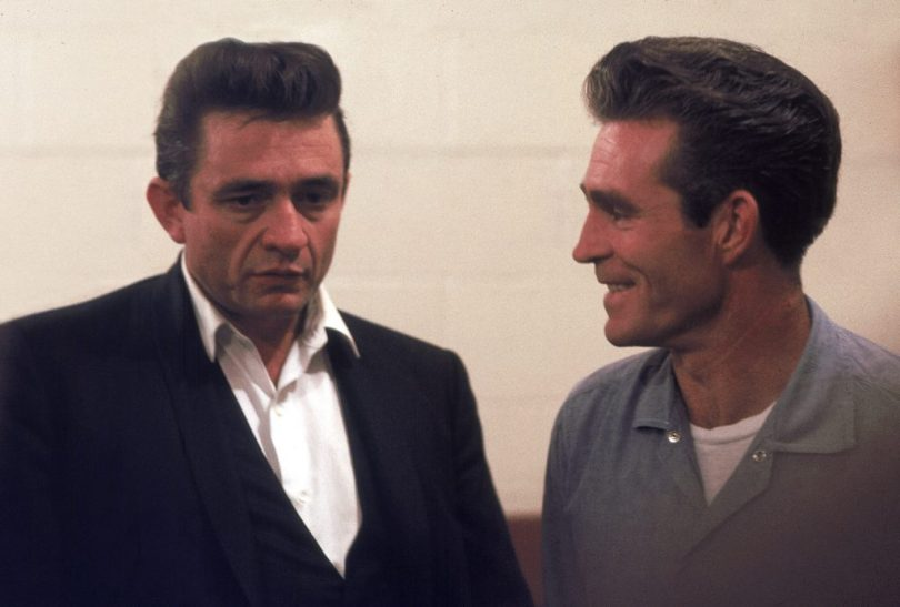 "Country singer Johnny Cash talks with Glen Sherley, a prisoner at the Folsom Prison in California on January 13, 1968, the day he recorded his live album ""Johnny Cash at Folsom Prison."" Sherley wrote the song ""Greystone Chapel"" on the album. (AP Photo/Dan Poush)"