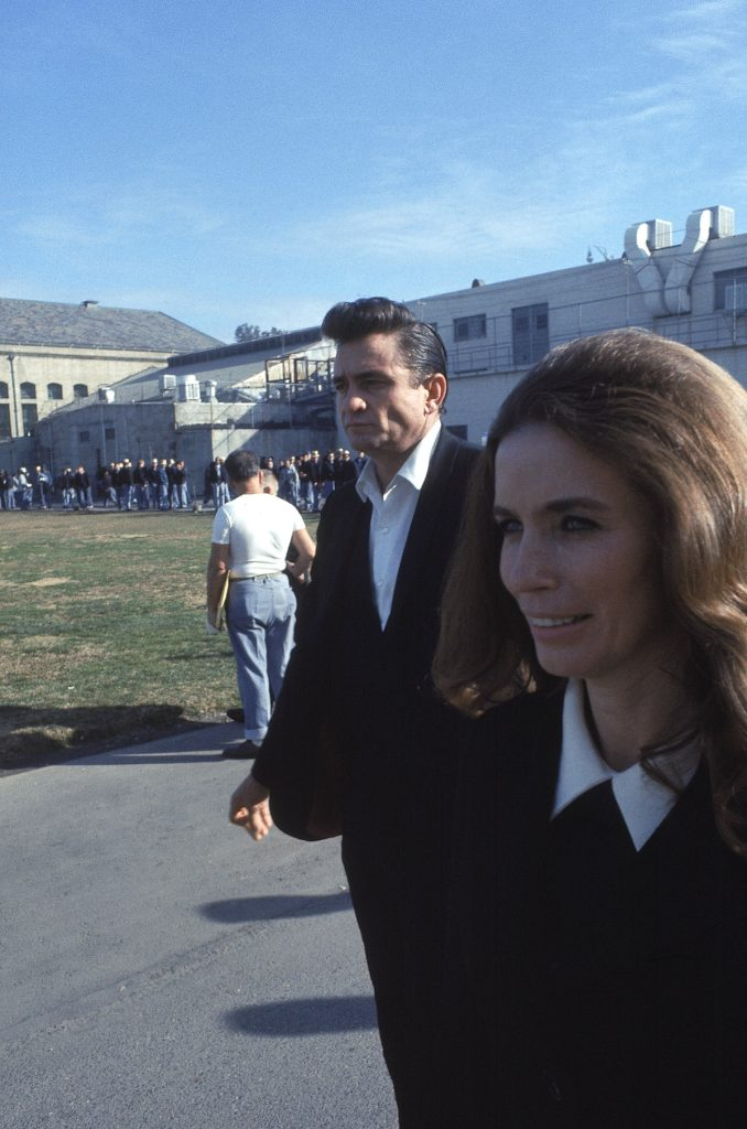 "Country singer Johnny Cash walks with June Carter outside the Folsom Prison in California on January 13, 1968, the day he recorded his live album ""Johnny Cash at Folsom Prison."" (AP Photo/Dan Poush)"