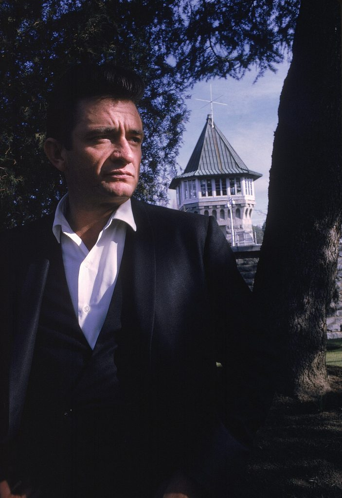 "Country singer Johnny Cash poses outside the Folsom Prison in California on January 13, 1968, the day he recorded his live album ""Johnny Cash at Folsom Prison."" (AP Photo/Dan Poush/Johnny Cash Collection)"