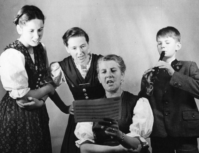 Portrait of Baroness Maria Von Trapp and three of her children, (L-R) Eleonore, Agatha and Johannes, singing from a piece of sheet music, London, circa 1950. (Photo by George Konig/Keystone Features/Getty Images)