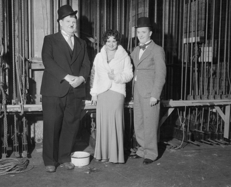 19 Dec 1932, Los Angeles, California, USA --- Original caption: Film folk at Benefit Show. Oliver Hardy, Helen Kane, Boop originator; and Stan Laurel (right) are seen here at the Christmas Benefit Show, staged by a Los Angeles newspaper, at the Shrine Civic Auditorium in Los Angeles. Radio, screen, and stage luminaries attended and participated in the festivities. --- Image by © Bettmann/CORBIS