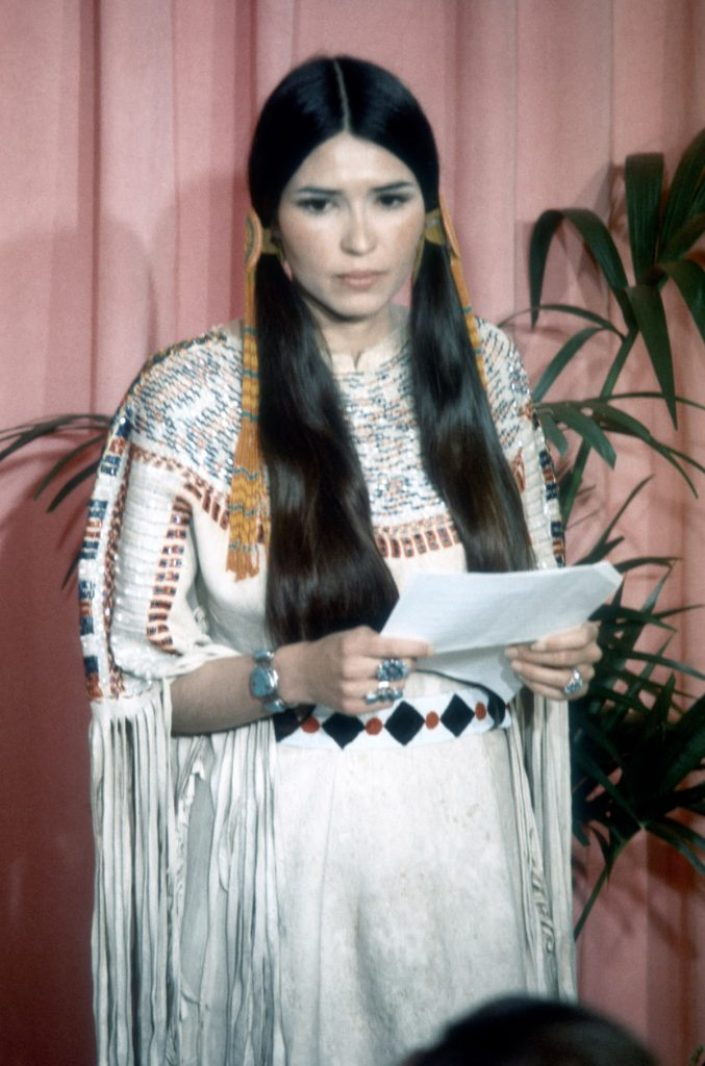 March 27 - LOS ANGELES: Sacheen Littlefeather (Native American actress Maria Cruz) holds a written statement from actor Marlon Brando refusing his Best Actor Oscar on stage at the Academy Awards on March 27, 1973 in Los Angeles, California. (Photo by Michael Ochs Archvies/Getty Images)