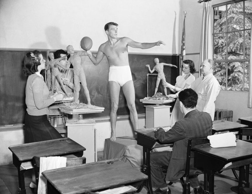 02 May 1940, Hollywood, Los Angeles, California, USA --- Actor Ronald Reagan poses for a sculpture class at the University of Southern California in 1940. He was chosen as an example of the ideal male physique by the school's fine arts departments, based on his portrayal of George Gipp. --- Image by © Bettmann/CORBIS