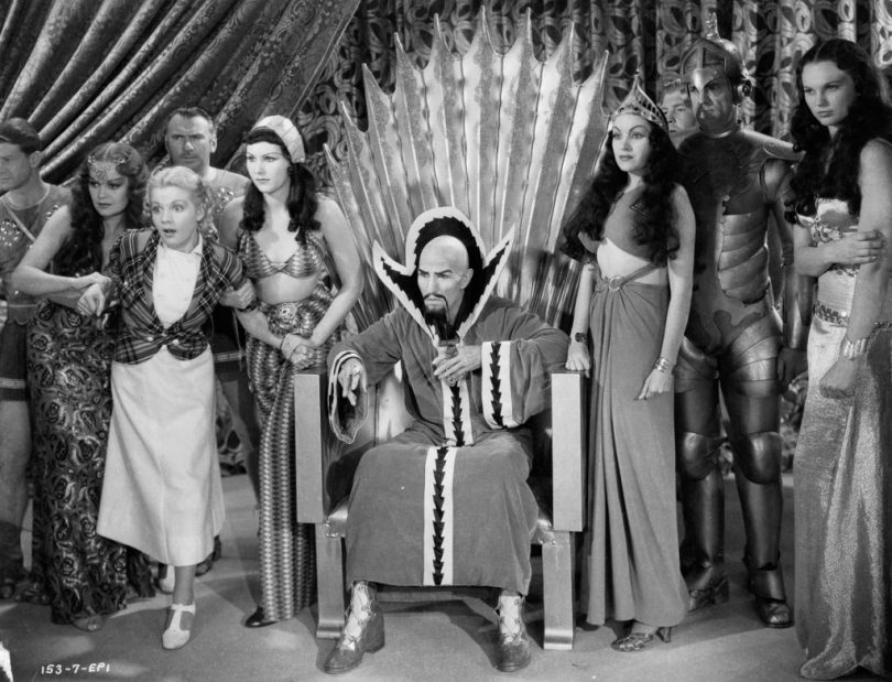1936: Dale Arden (played by Jean Rogers, 1916 - 1991) struggles in the grip of two servants of Ming the Merciless (Charles Middleton, 1879 - 1949) and his daughter Princess Aura (Priscilla Lawson, 1914 - 1958) in a scene from episode one of the sci-fi classic 'Flash Gordon', directed by Frederick Stephani. (Photo via John Kobal Foundation/Getty Images)